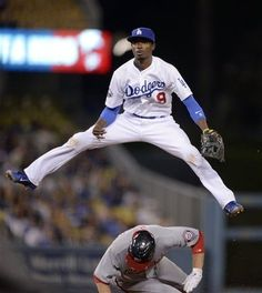 Dee Gordon goes high over Adam LaRoche during the Dodgers 3-2 win over the Nationals on April 27, 2012.
