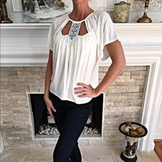 Gorgeous Cut out white top! Darling swing top with top cut out and detailed design on top! En Creme Tops Blouses