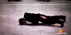 Bruce Lee performing a two-finger push-up.