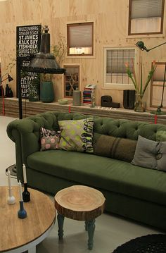 Neon colors with an antique olive green sofa.