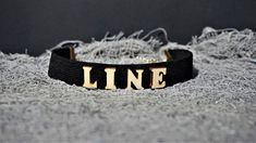 Finish off your look with this super cute LINE Letter Choker necklace.Take your outfit to the next level with this black wooden choker. * Length: 30 cm * Width: 2 cm * Chain link whit lobster clasp * Letters material: wood * Band material: elastic Available in black,red and white color