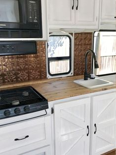 Eclectic Camper Design from 2 Girls 1 Camper Tour this eclectic camper with rustic details and copper accents from 2 Girls 1 Camper! Featured on Camper Design Vibes! Home Renovation Loan, Camper Renovation, Camper Remodeling, Kitchen Remodeling, Travel Trailer Remodel, Camper Storage, Rv Interior, Interior Ideas, Camper Makeover