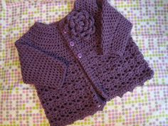 Crochet baby sweater in soft yarn and vibrant colours.