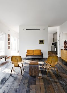 Harwood Floors, Wooden Chairs, Mustard Sofa in this Bright Living Room #interiors #home
