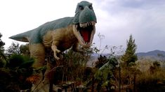 While driving on Interstate 10 near Cabazon, California, it's hard not to miss two gigantic dinosaurs standing amid the barren and arid land of the desert off California Attractions, Roadside Attractions, Cabazon Dinosaurs, Road Trip Across America, Plastic Dinosaurs, Gas Station, Statues, Lion Sculpture, Travel