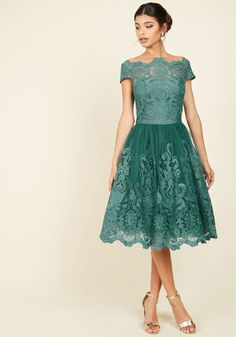 Make an unforgettable entrance in this decadently embroidered dress by Chi Chi London! With an ornate illusion neckline, intricate scalloped lace, and a full, tulle-lined skirt, this teal frock exudes timeless feminine flair.