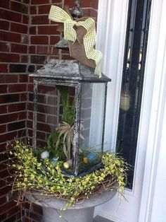 Add a bunny, ribbon and spring wreath to any lantern for a quick and Easter Welc. Add a bunny, ribbon and spring wreath to any lantern for a quick and Easter Welcome! Porch Lanterns, Lanterns Decor, Outdoor Lantern, Outdoor Lighting, Outdoor Decor, Porch Decorating, Decorating Ideas, Decor Ideas, Decorating For Spring