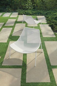 I don't really want to mow my yard, but I'm digging the graphic running bond pattern of the cement slabs. Oh, and the chairs are great, too.