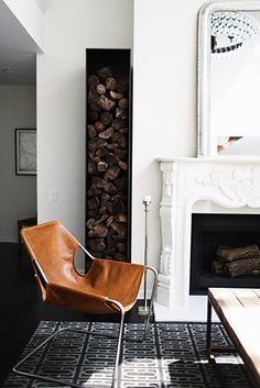 Designer Crush: @catherine gruntman Wong // living rooms // ornate fireplace, firewood, geometric rug, leather sling chair