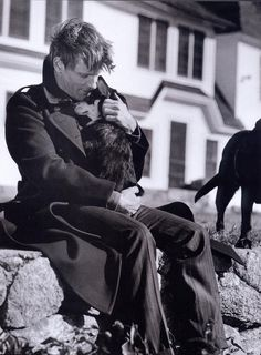 Awww, Viggo Mortensen keeping a dog warm...