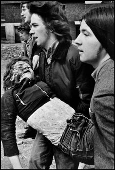 A child is injured during the riots in Belfast, 1972, by Gilles Peress