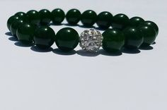 The majesty of deep green Jade compliments the shine of a singular white pave bead. *All designs can be altered using the beads of your choice. Jade Green, Natural Gemstones, Compliments, Create Yourself, Beaded Bracelets, Couture, Beads, Silver, Jewelry