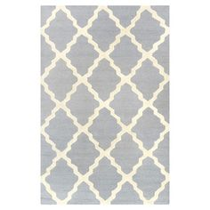 Anchor your living room seating group or define space in the den with this handcrafted wool rug, showcasing a chic trellis motif in spa blue.