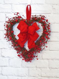 Valentine Wreath, Red Berry Heart Wreath, Valentine Decoration, Grapevine Valentine  A garland of red mixed berries swirl around this grapevine heart and a handcrafted red bow completes this Valentine design.  This heart wreath hangs from a red ribbon loop. -- FINISHED DIMENSIONS: 14 inches wide, 14 inches long (tip to tip of extending decor) 6 inches deep  (The Unfinished Heart measures 11 x 11).  -- For inside, or outdoors in a covered area protected from the weather elements. Berries…