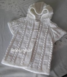 No automatic alt text available. Poncho Knitting Patterns, Knitting Designs, Free Knitting, Crochet Patterns, Crochet Baby Poncho, Knitted Poncho, Baby Cardigan, Baby Sweaters, Crochet For Kids