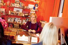 Burch holds one of a string of daily staff meetings in her vibrant orange office.