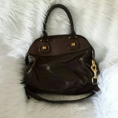 Sale!! Host Pick Givenchy Dark Brown nightingale Really a great bag and I love it but need to sell items I don't use as much. Can be handheld, worn on the arm or on the shoulder. Super roomy and in great condition. Comes with a dust bag but not the original one. Open to offers pls make them thru the offer option. Want more pics? Email me what you want and I will send them. Justprincessj@gmail.com Givenchy Bags