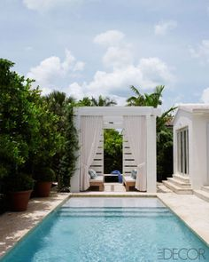 In Miami, a pergola designed by Aparicio is shaded with curtains of a Holly Hunt fabric.