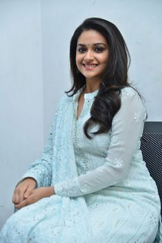 Keerthy Suresh Stills at Mahanati Film Interview. Keerthy Suresh donned a pastel blue chikankari palazzo suit which she styled it with a pair of silver oxidized jhumkis and silver kolhapuri chappals. Bollywood Actress Hot Photos, Beautiful Bollywood Actress, Most Beautiful Indian Actress, Tamil Actress, Churidar Designs, Kurta Designs Women, Bollywood Hairstyles, Dress Indian Style, Indian Wear