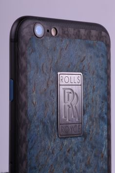 Feld & Volk Atelier embodies any wish of the clients. Custom gadgets for one of Rolls-Royce fans features unique combination of treated relict wood (Karelian birch), carbon fiber back frame and platinum logo with glowing effect. This item is also available for sale.
