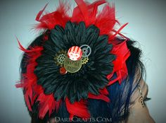 "Tina Hair Flower #DEHF45 Pin up hair flower in black, gears, a red flapper button and an ""Inspire"" medallion surrounded by red feathers www.darecrafts.com #darecrafts #creativelife #inspiration #costuming #divergent #embellishments"