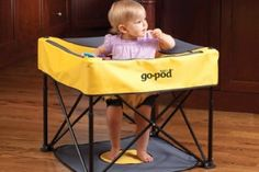 portable activity center for baby. folds up into a small bag. great for travel or small spaces.