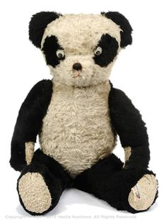"""Lefray black and white mohair panda bear, British, 1950s/60s, black and white plastic eyes with floating pupils, fully jointed, white artificial silk pads with black claw stitching, 33""""/84cm"""