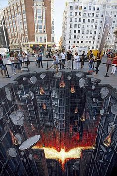 This enormous painting broke two Guinness World Records for the longest and largest 3D street art in London's Canary Wharf. It took ten days days to complete. It measured 1,160.4 square metres and 106.5 metres long. Awesoome!!!