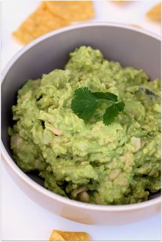White bean avocado guacamole dip with tomatoes, red onions, garlic, lime juice, cilantro and jalapeno.