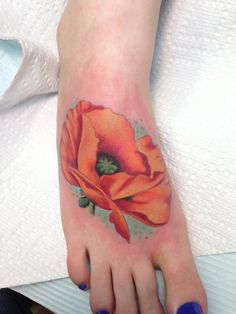 Poppy Tattoo. I think I need to get a poppy tattoo, maybe a small clutch of them...