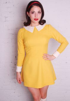 You'll show off a sunny attitude in this buoyant retro inspired frock. 100% polyester Color: Yellow