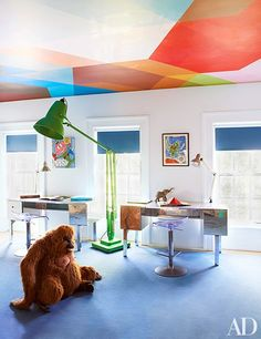 A playroom ceiling covered in a lively Flavor Paper wallpaper | archdigest.com