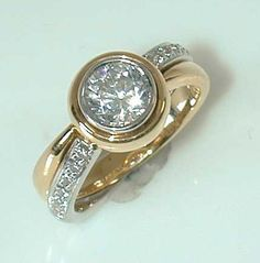 A Mark Patterson Engagement Ring in Yellow Gold and Platinum....
