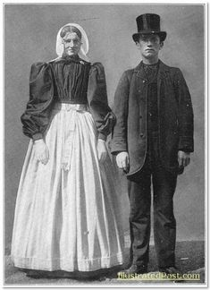 Ducth Bride and Groom in Traditional Dress. The top hat seems to be a foreign influence.