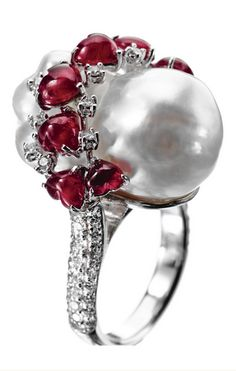 BAROQUE CULTURED PEARL, RUBY AND DIAMOND RING, SIFEN CHANG The baroque cultured pearl measuring approximately 21.8 by 13.6 mm., surmounted by a wavy band of 9 heart-shaped cabochon rubies weighing approximately 7.45 carats, completed by small round diamonds weighing approximately 1.00 carat, mounted in 18 karat white gold, size 6,  signed with Chinese characters for Sifen. With signed box.