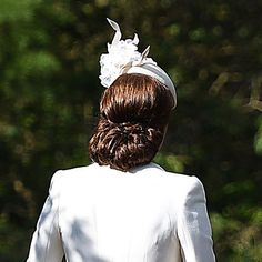 Catherine Duchess of Cambridge looked stunning in a cream outfit and fascinator while attending her daughter Princess Charlotte's christening in England on July 5