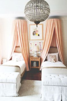 Blush canopies, orb chandelier, art