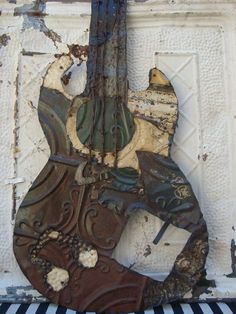 guitar made from old tin ceiling tiles