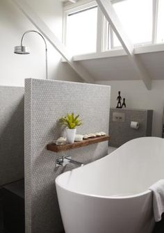 bathtub against shower wall