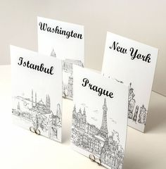 Black and white sketches of cities for table names. World Travel Theme Table Number Cards - Black and White Sketches of Cities of the World Wedding Table Themes, Card Table Wedding, Wedding Table Numbers, Wedding Cards, Party Themes, Wedding Decorations, Wedding Seating, Theme Ideas, Wedding Ideas