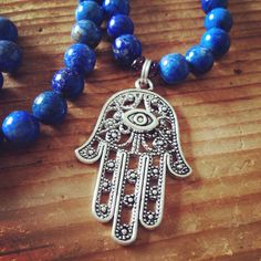 New Lapis Lazuli and Garnet Mala with Hamsa Pendant!!!  http://theeasiersofterway.com/product/lapis-lazuli-mala-hamsa-pendant/  Lapis Lazuli is a healing stone, representing the Medicine Buddha Bhaiṣajyaguru.  Garnet is a powerful stone that helps us build stability and confidence.  The hamsa is an ancient symbol that protects its wearer from negativity.  #mala #malabeads #lapislazuli #hamsa #lapis #garnet #108beadmala #buddhistmala #japamala #meditation #prayerbeads