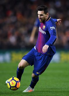 Lionel Messi of FC Barcelona runs with the ball during the La Liga match between Valencia and Barcelona at Mestalla stadium on November 26, 2017 in Valencia, Spain.