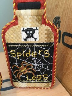Kirk & Bradley needlepoint Halloween bottle