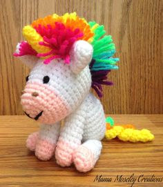 Small crochet rainbow unicorn. This unicorn measures about 6 tall. The mane and tail are made in a variety of colors (pink,red,orange,yellow,light blue, and purple shown) and can also be made in solids. 3 colors maximum for the tail.