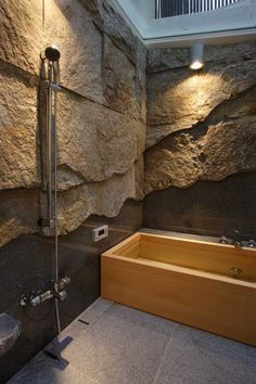 Bathtub made out of wood. Love the stone accents!