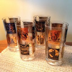 """Set of four Frank Maietta """"Seven Wonders of the World"""" retro glasses by FromTheSeller on Etsy"""