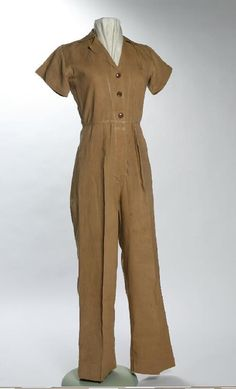 Woman's tan cotton coverall uniform worn by Margaret Michaelree during WWII while working at an ordinance plant. Ca. 1940s | Missouri History Museum #vintage #vintagefashion #WWII