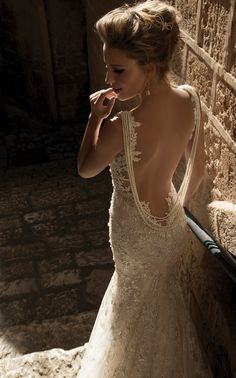 Do you dare to bare a little skin in back when you walk down the aisle? If the answer is yes, then get ready to fall head over heels for these open back Galia Lahav wedding dresses that are even more gorgeous from the back. Take a look!