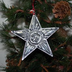 This hand crafted tin star adds a classic and elegant look to any Christmas tree. The punch design helps to reflect and intensify your tree lights, illuminating the whole room. Silk and beaded fabric tie. Fair Traded from Bali. Easy Christmas Ornaments, Christmas Tree Art, Handmade Ornaments, Father Christmas, Wire Crafts, Metal Crafts, Autumn Crafts, Holiday Crafts, Tin Foil Art