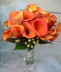Orange calla lily bridesmaid bouquet